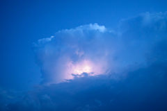 Lightnings in storm clouds. Peals of a thunder and the sparkling lightnings in clouds Stock Photo