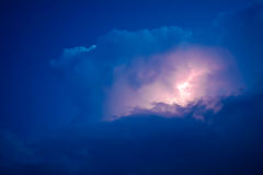 Lightnings in storm clouds. Peals of a thunder and the sparkling lightnings in clouds Stock Images