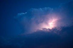 Lightnings in storm clouds. Peals of a thunder and the sparkling lightnings in clouds Stock Photography