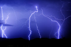 Lightnings strike. Many lightnings and blue sky with clouds Stock Image