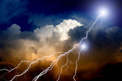 Lightnings in sunset sky Royalty Free Stock Images