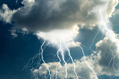 Lightnings and thunder bold strike Stock Photography