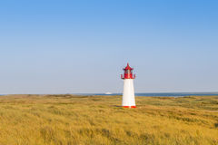 Lightouse on dune. Sylt island. Lightouse on dune. Golden hour Stock Photo