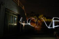 Lightpainting le mot : Amour Photos stock