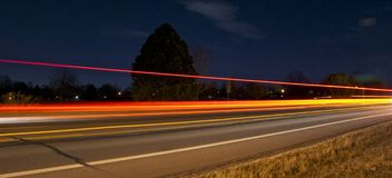 Lightpainting Passing Cars. Using slow shutter was able to catch the lights from cars Stock Images