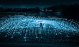 Lightpainting with steel wool. Steel wool in a wisk, start swinging stock image