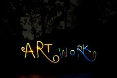 Lightpainting writing the word art work in darkness. Light Painting Photography is the Art Form of using handheld lights to paint and/or draw in a scene while royalty free stock photography