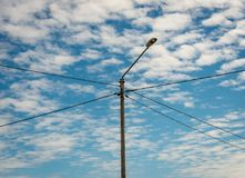 Lightpost with electrical wires connecting in a cross royalty free stock photos