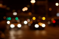 Lights. Out of focus lights of traffic passing by on a street at night Royalty Free Stock Photography