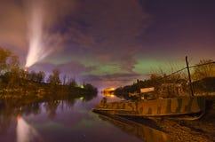 Lights above the lake,man with a dog-Aurora borealis Royalty Free Stock Photos