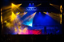 Lights beams on stage at Summer Night Festival. Fun, youth, entertainment and fest concept royalty free stock photo
