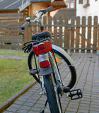 Lights  bike whee one wooden lodge Stock Photo
