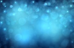 Lights on blue background. Bokeh effect Royalty Free Stock Photography