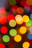 Lights blurred bokeh background from christmas night party for your design, vintage or retro color toned Stock Photos