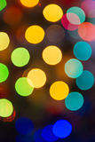 Lights blurred bokeh background from christmas night party for your design, vintage or retro color toned Royalty Free Stock Photos