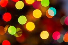 Lights blurred bokeh background from christmas night party for your design, vintage or retro color toned Stock Image