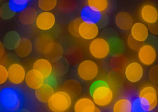 Lights blurred bokeh background from christmas night party for your design, vintage or retro color toned Royalty Free Stock Images