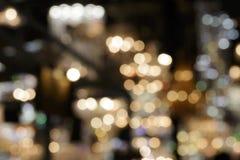 Lights blurred bokeh background from chrystal chandelier Stock Image