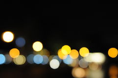 Lights blurred bokeh background from night party for your design Royalty Free Stock Images