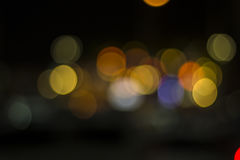 Lights blurred bokeh background from restaurant with beside sea Stock Photography