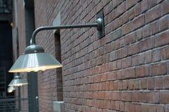 Lights on a brick wall. A row of metal lights on a brick wall Stock Image