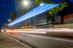 Lights of a Bus passing by in a long exposure light painting on the streets stock images
