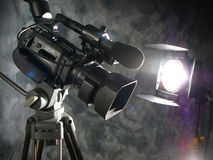 Lights, Camera, Action!. Close up of Digital Video camera and production light Royalty Free Stock Photos