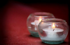 Lights Candles With Fire in glass. Lights candles with fire on dark background ** Note: Shallow depth of field royalty free stock images