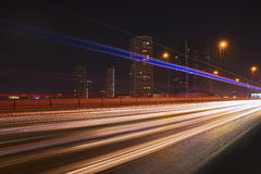 Lights of a car in the city at night. Speed of light in the city Royalty Free Stock Image