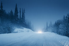 Lights of car and winter road Stock Image