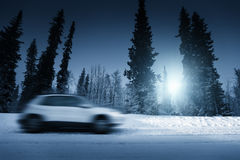 Lights of car and winter road Stock Images