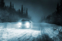 Lights of car and winter road Royalty Free Stock Photography
