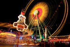 Lights at carnival at night. A view of lights and amusement rides at a carnival at night royalty free stock photography