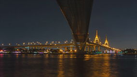 Lights from cars and boats to the bridge at night. Lights of the car on the freeway and the boat under the bridge at night,Time Lapse stock footage