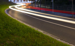 Lights of the cars on the road to the tunnel. Royalty Free Stock Images