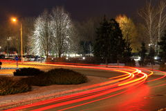 The lights of cars on the road  in winter. Stock Photo