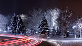 The lights of cars on the  winter road. Royalty Free Stock Image