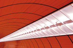 Lights on the ceiling. Bright neon lights of an underground station in munich Stock Image