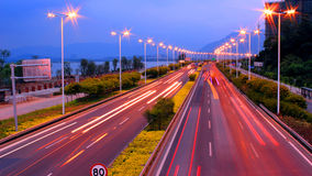The lights on. City, at dusk, the lights, lighting, emit light, light create brilliant light trajectory, charming night view Stock Image