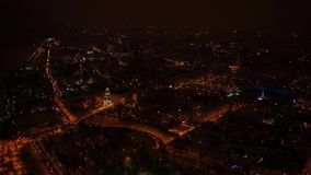 Lights of the city at night, view from the heights, captured on drone. 4K stock video footage