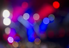 Lights at the concert at night, blurred background, image out of focus. Bright lights at the concert at night, blurred background, image out of focus stock images