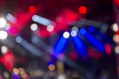 Lights at the concert at night, blurred background, image out of focus. Bright lights at the concert at night, blurred background, image out of focus stock photography