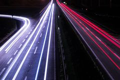 Lights crossing the road at night stock photography