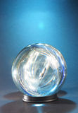 Lights within crystal ball aga. Inst blue light in the background Royalty Free Stock Photography