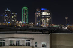Lights of the Dalllas skyline at night behind apartment building Stock Photo