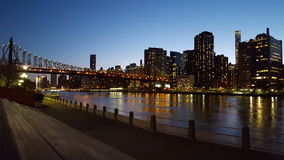 Lights dancing on the water. View of 59th street bridge and Manhattan from Roosevelt Island Stock Photos