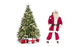 Lights decorated xmas tree with gift boxes and Santa Claus happy dancing on white background with text space to place stock video