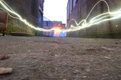 Lights down an old brick alley Royalty Free Stock Images