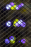 Lights equipment through a grid Royalty Free Stock Image