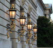 Lights in the Federal Triangle. Four large black and brass lighted lamps on a building in the Federal Triangle area in DC Royalty Free Stock Image